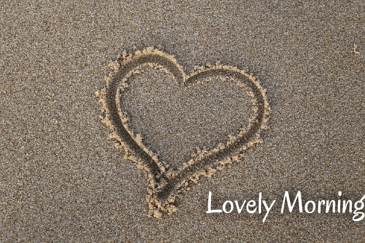 a heart draw on sand lovely morning