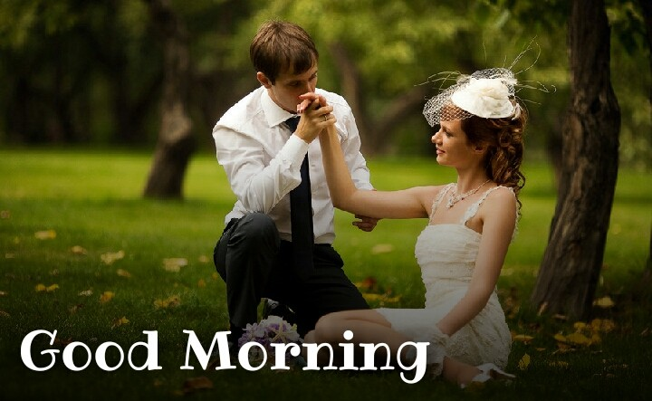 boy kisses his girlfriends hand morning time